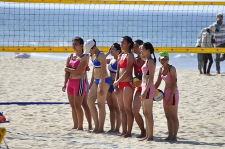 Four unidentified teams plays in a beach volley competition on July 09, 2010 at the Hoi An Beach, Vietnam. A TV team was filming this event.