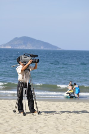 Unidentified cameraman films a beach volley competition on July 09, 2010 at the Hoi An Beach, Vietnam.