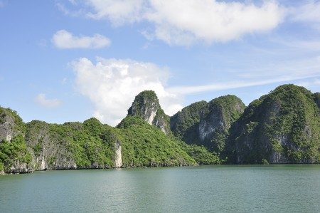 Sea, sky and an island mountains viewed from Halong Bay, Vietnam