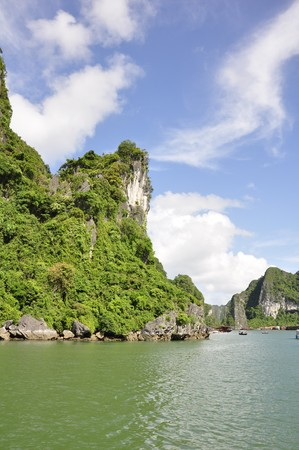 Sea, sky and island mountain side viewed from Halong Bay, Vietnam Stock Photo