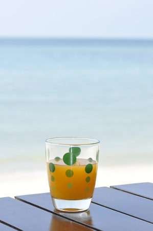 A glass of orance juice at the beach in Chaweng, Koh Samui, Thailand Stock Photo