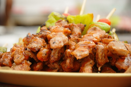 Thai cuisine barbecue chicken skewers at Chatuchak weekend market in Bangkok, Thailand