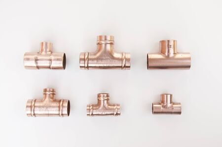 soldered: Different types of copper plumbing soldered tee fittings Stock Photo