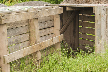 Wooden crates standing on grass Stock Photo - 13985243