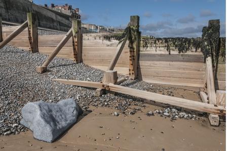groyne: Wooden groyne sea defence on beach Stock Photo