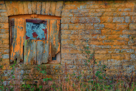 boarded up: Old boarded up window in a stone farm building Stock Photo