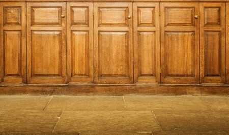 hinged: Old varnished wooden hinged cupboards with handles Stock Photo