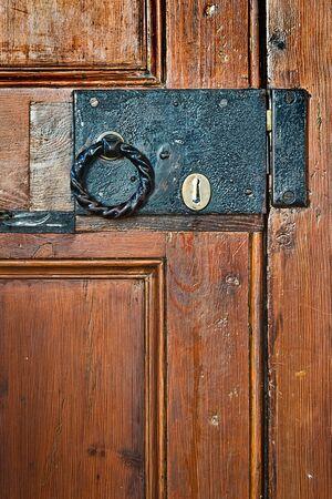 door handle: Old rectangular black lock with round handle on door Stock Photo