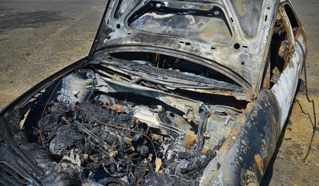 abandoned car: Abandoned car torched set on fire and burnt out Stock Photo