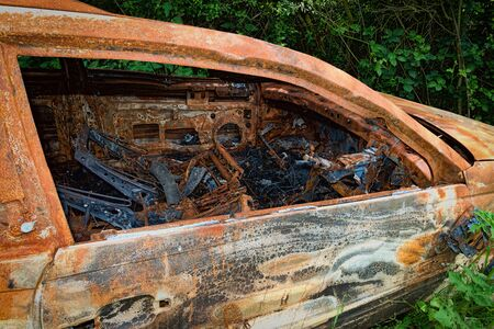 burnt out: Rusty & burnt out car showing damage inside Stock Photo