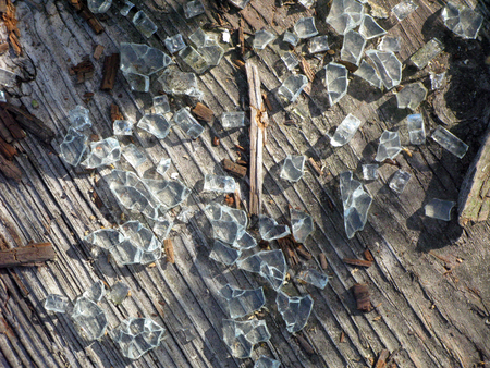 Close-up of weathered broken glass on wooden deck undisturbed for a long period of time Stok Fotoğraf