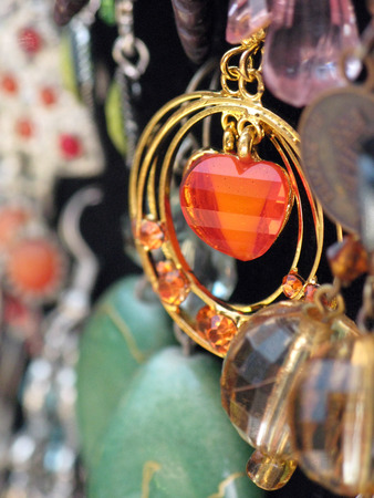 Hanging earrings orange colored with gold hoops Stok Fotoğraf