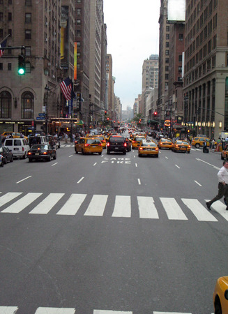 City Street crosswalk with taxis and tall buildings