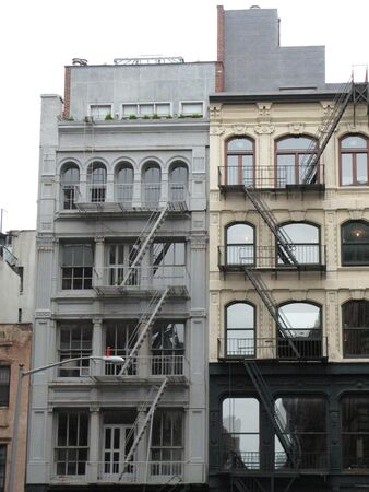 Old city buildings with fire escapes on the front
