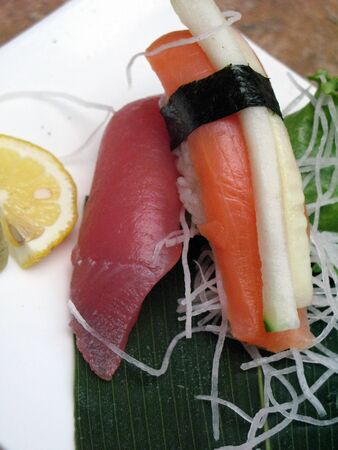 Smoked salmon and tuna Sushi with lemon