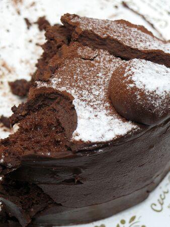Close-up of Chocolate cake with fudge and powdered sugar Stock Photo