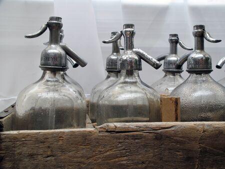 seltzer: Old Antique seltzer soda bottles for soade jerk close up Stock Photo