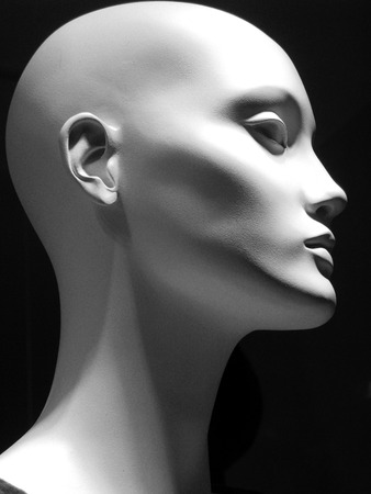 mannequin head: Black and white image of a white mannequin head PROFILE on a black background