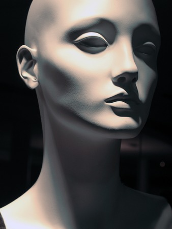 mannequin head: Close-up if a painted white mannequin head with shadow lighting Stock Photo