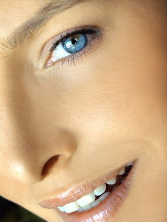 Natural make-up beauty image of girl with blue eyes and white teeth smiling photo
