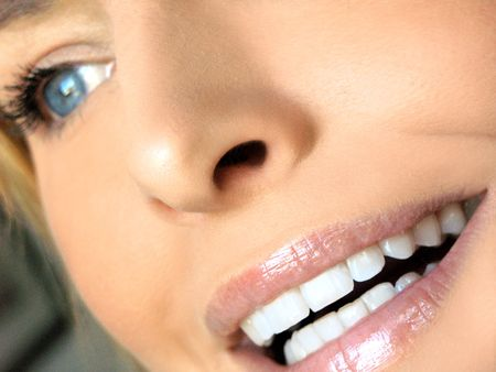 Close-up of blonde blue-eyed girl with focus on mouth and teeth