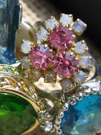 Close-up of pink amethyst and opal ring next to various colored glass rings Stok Fotoğraf