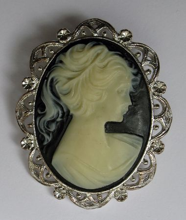 green gemstone: Cameo on black with silver frame pendant