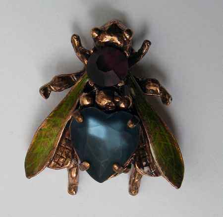 Antique fly costume jewelry made of bronze with faux ruby