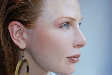 cosmetic  image of fashion model profile with red hair and blue eyes