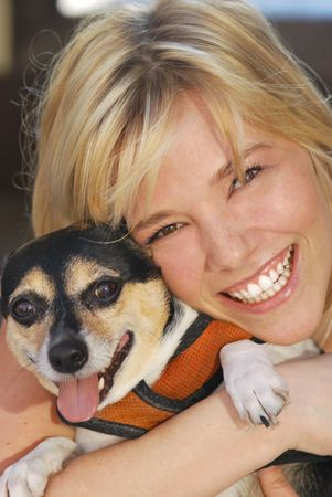 Blonde Girl holding Jack Russell Dog Outside photo