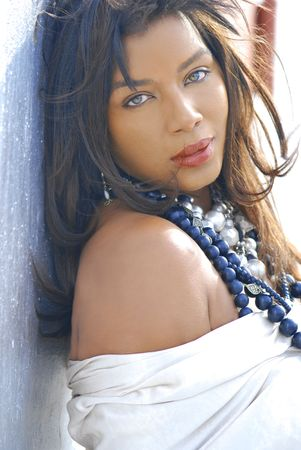 Black woman wearing beads and metal jewelry outside Close-up photo