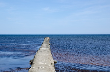 Bridge into blue water Stock Photo