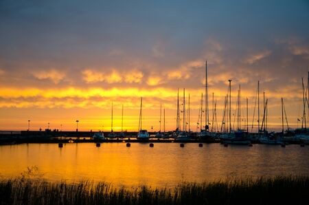 Sailboats in sunset photo