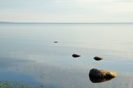 timeless: Calm and bright water with stones