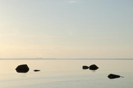 Black rocks in calm water Stock Photo - 14472524