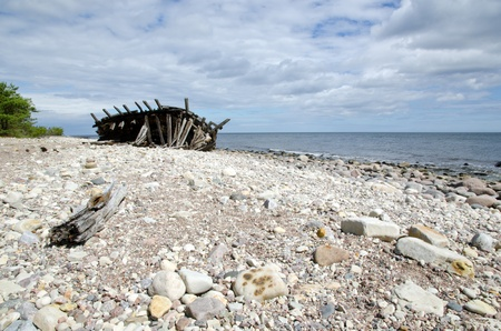oland: Old wooden shipwreck at coast Stock Photo