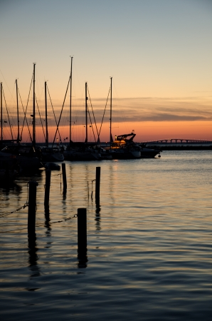 oland: Sunset at harbour and bridge in background Stock Photo