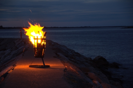 Small bonfire at a harbour pier photo