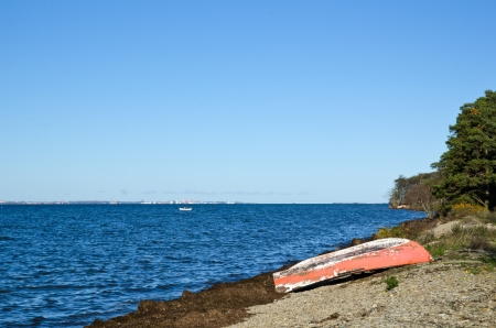 Old fashioned rowing boat at coast photo