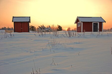Red cabins in sunrise Stock Photo - 17069494