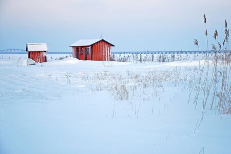 Red cabins in winter landscape Stock Photo - 17275171