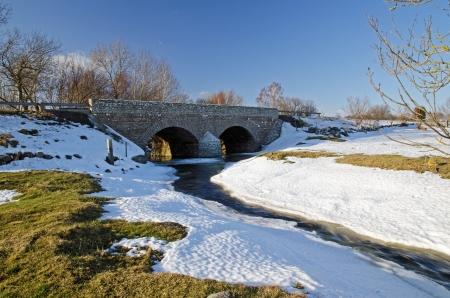 Old bridge in early springtime Stock Photo - 17330558