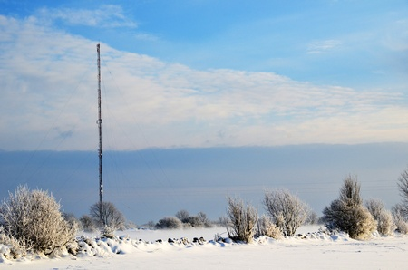 Telecoms mast in a rural winter landscape photo
