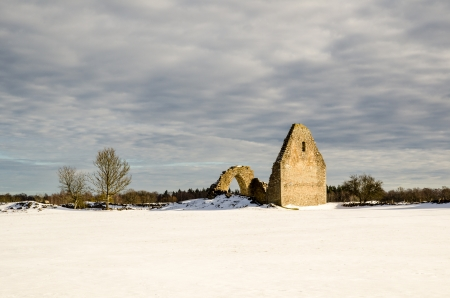 Sunlit old chapel ruin at Borgs village on the island Öland in Sweden photo