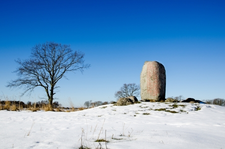 oland: Ancient burial place marked with a famous runestone at Karlevi on the island Öland in the Baltic Sea