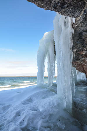 Icy limestone cliffs at the coast of the swedish island land in the Baltic sea