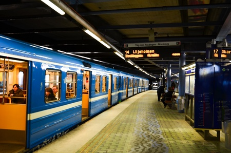 Train with open doors waiting at a station by Stockholm metro