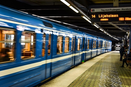 A passing metro train at a station by Stockholm subway in Sweden