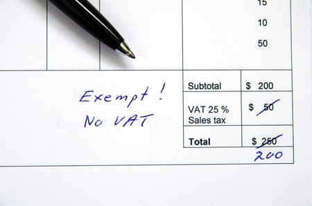 exempt: Detail from an invoice with the total amount changed because incorrect VAT, exempt