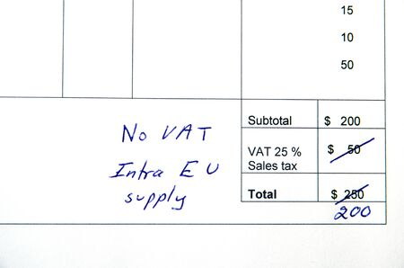 changed: Detail from an invoice with the total amount changed because incorrect VAT, intra EU supply